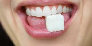 ashamed to go to the dentist teeth holding sugar